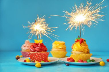 Festive bright cupcakes with sparklers