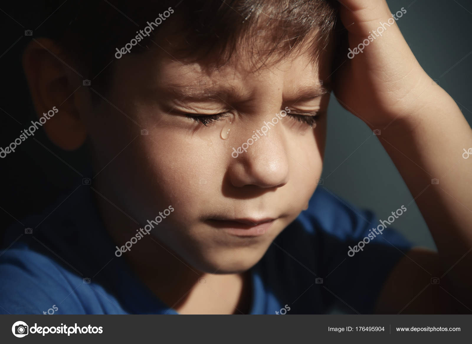 Little sad boy crying abuse of children concept stock photo