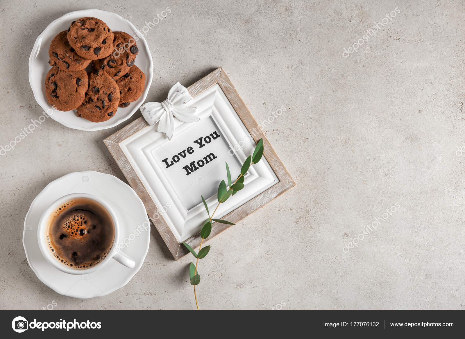 Cup of coffee, chocolate cookies and photo frame with words \