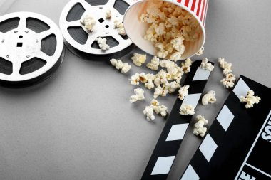 popcorn, movie clapper and cinema film