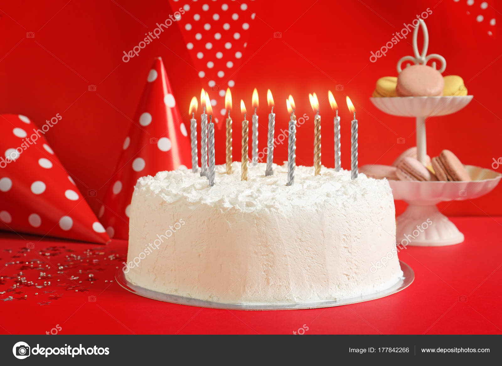 Birthday Cake With Candles On Table Against Red Wall Stock Image