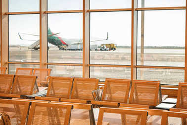 Waiting room with empty seats in modern airport