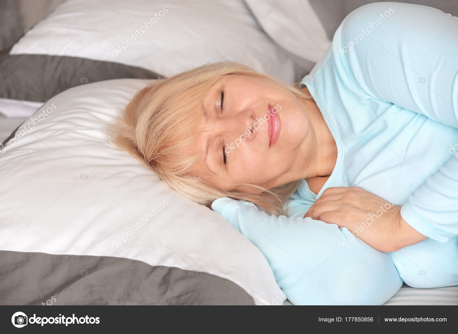 Beautiful Mature Woman Sleeping In Bed At Home  Stock Photo  Belchonock 177850856-7662