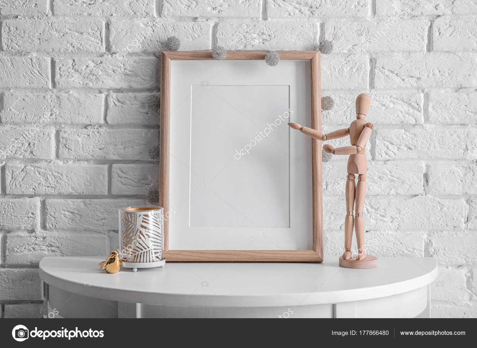 Mockup of blank frame with mannequin on table — Stock Photo ...