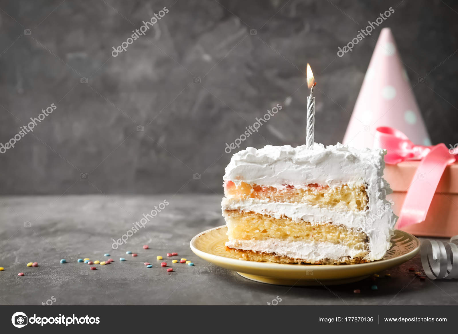 Astonishing Piece Of Birthday Cake With Candle On Table Stock Photo Personalised Birthday Cards Petedlily Jamesorg