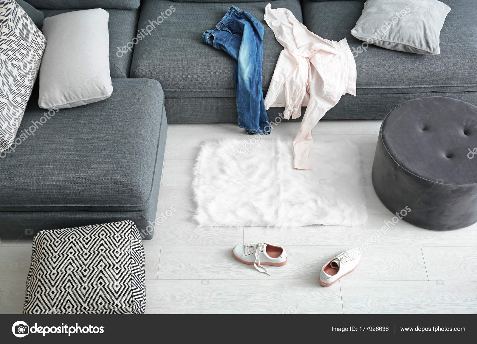 Dirty laundry scattered in living room — Stock Photo © belchonock ...