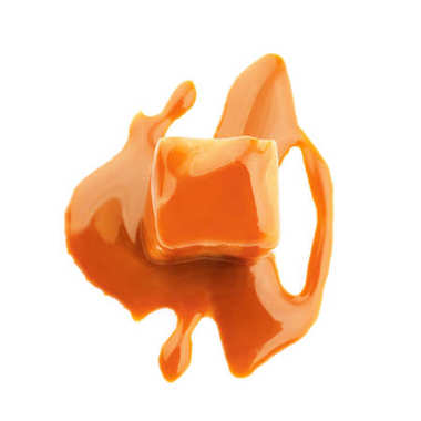 Delicious candy with caramel sauce