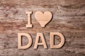 Fotografie Composition with phrase I LOVE DAD for Fathers Day on wooden background