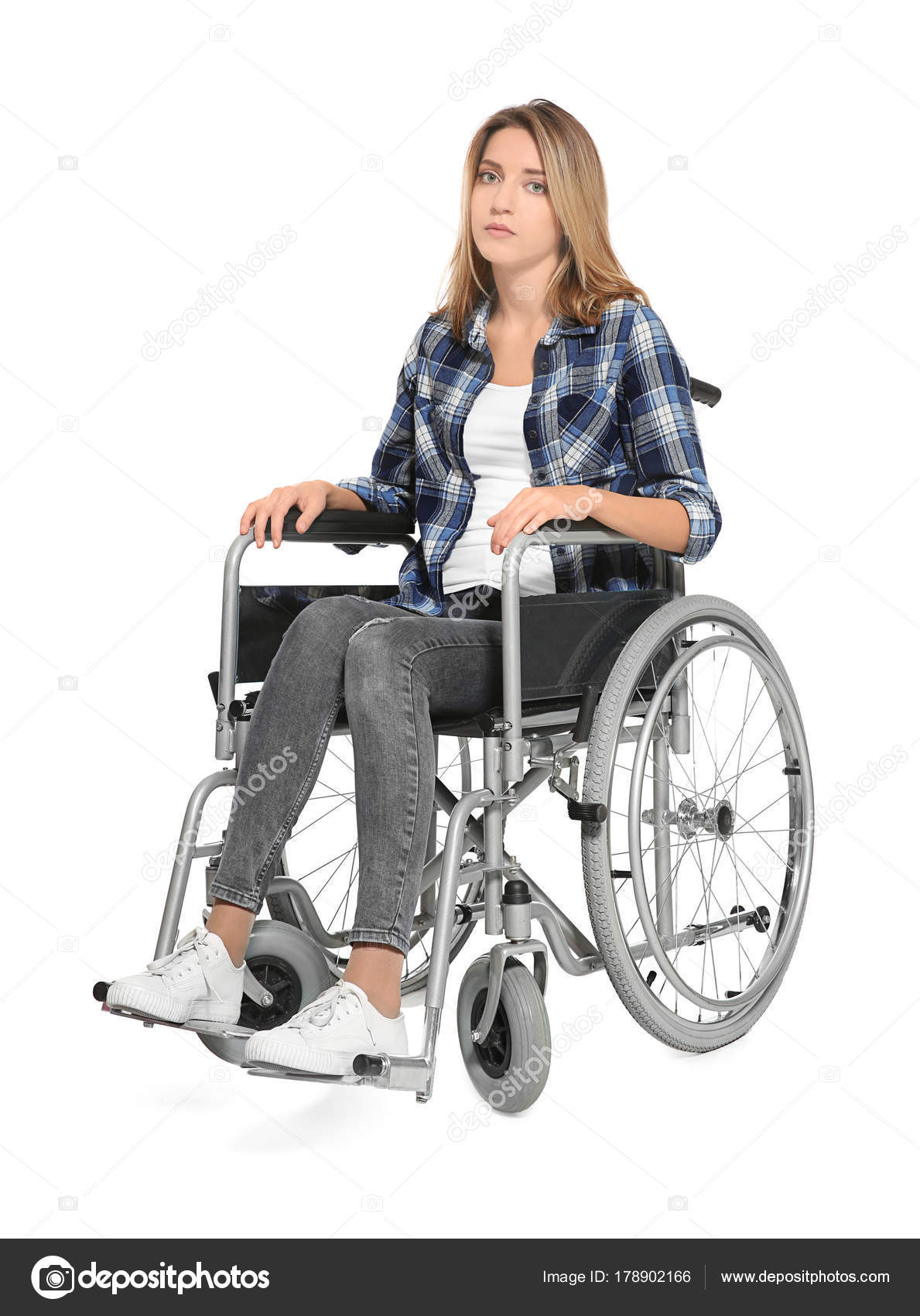 young woman in wheelchair on white background stock photo