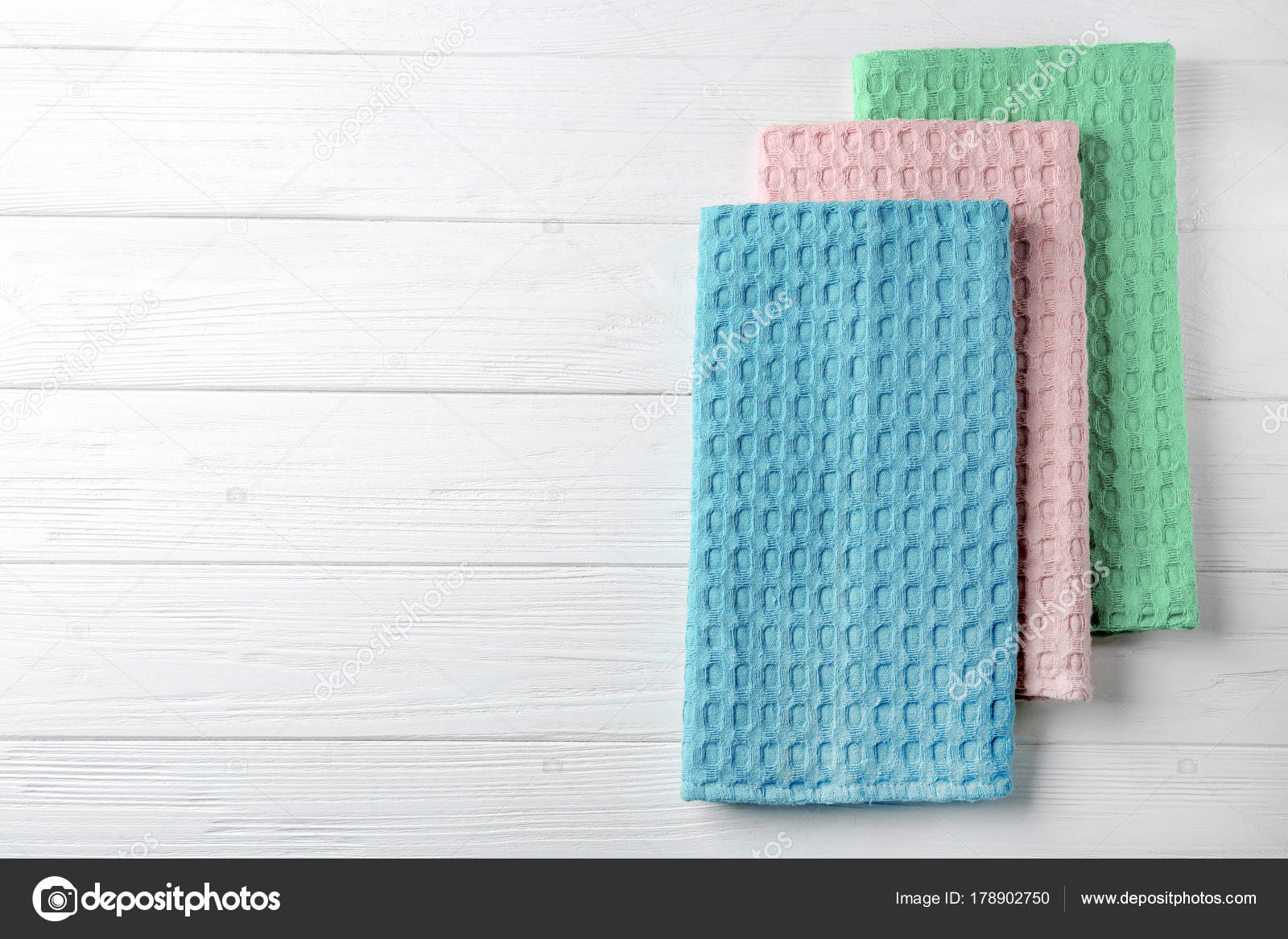 Clean kitchen towels on white wooden table, top view — Stock Photo ...