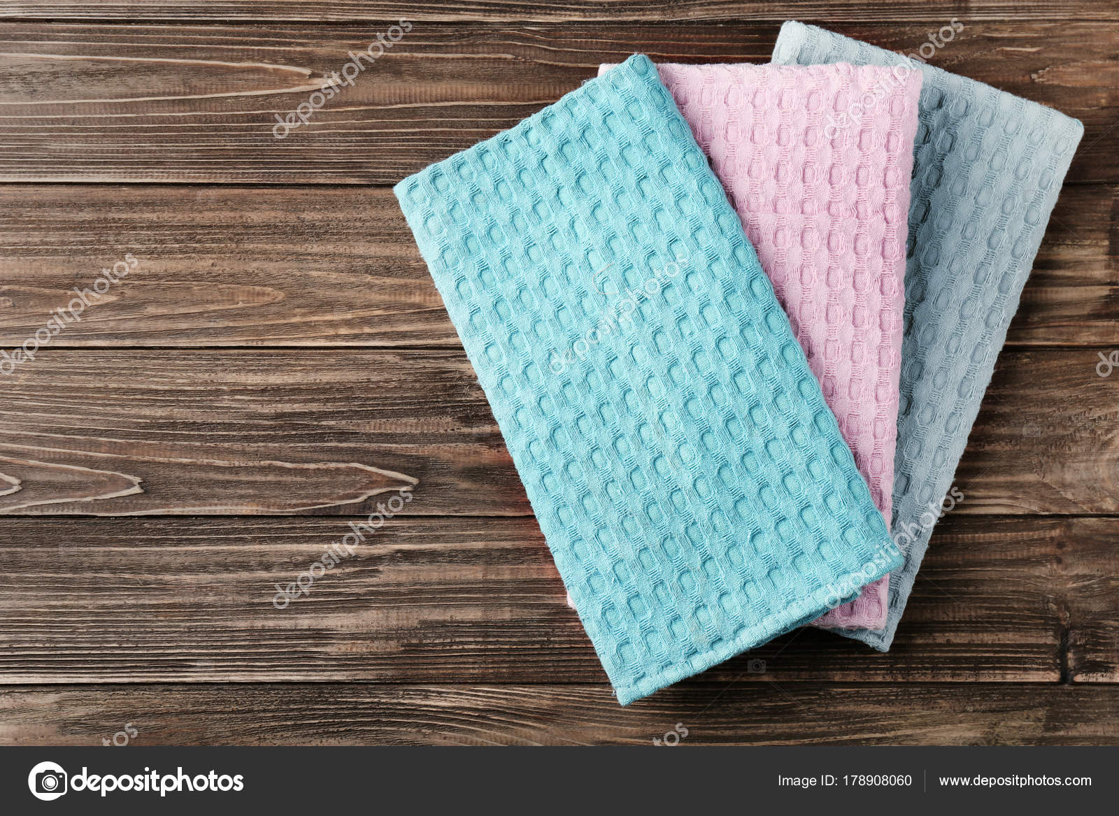 Clean kitchen towels on wooden table, top view — Stock Photo ...