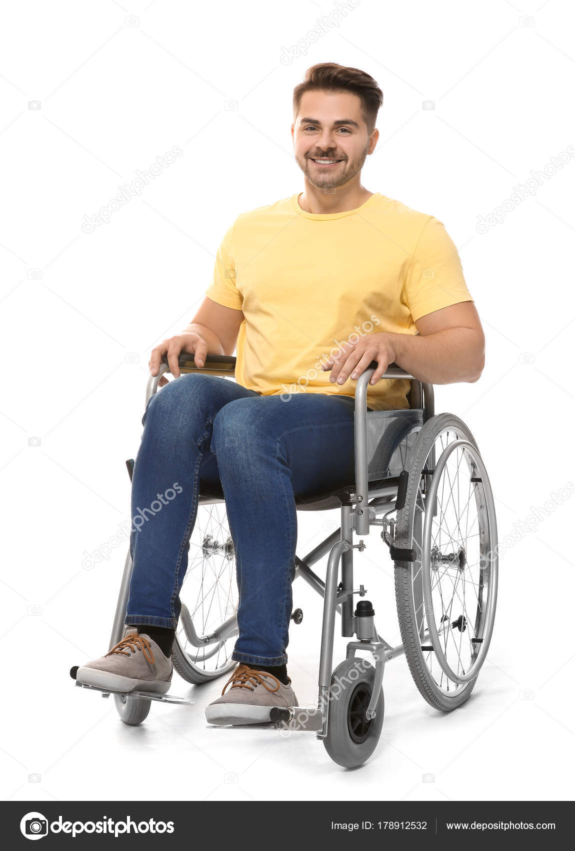young man in wheelchair on white background stock photo
