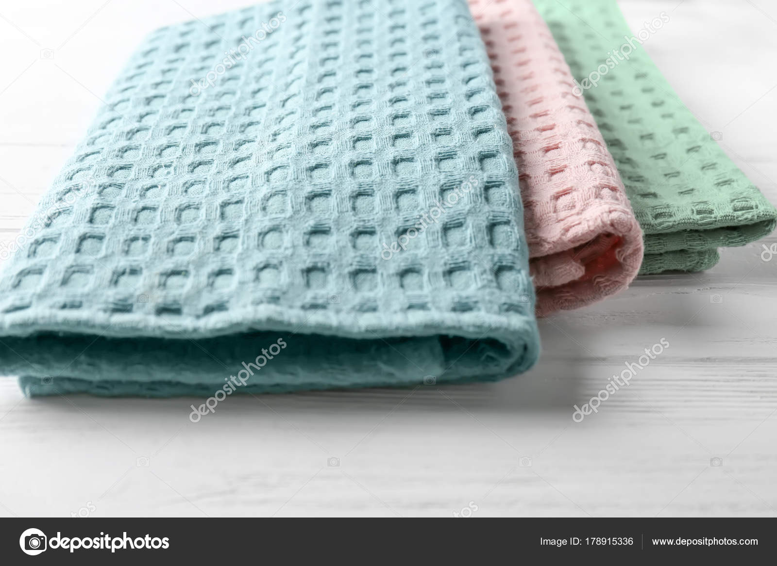Clean kitchen towels on white wooden table, closeup — Stock Photo ...