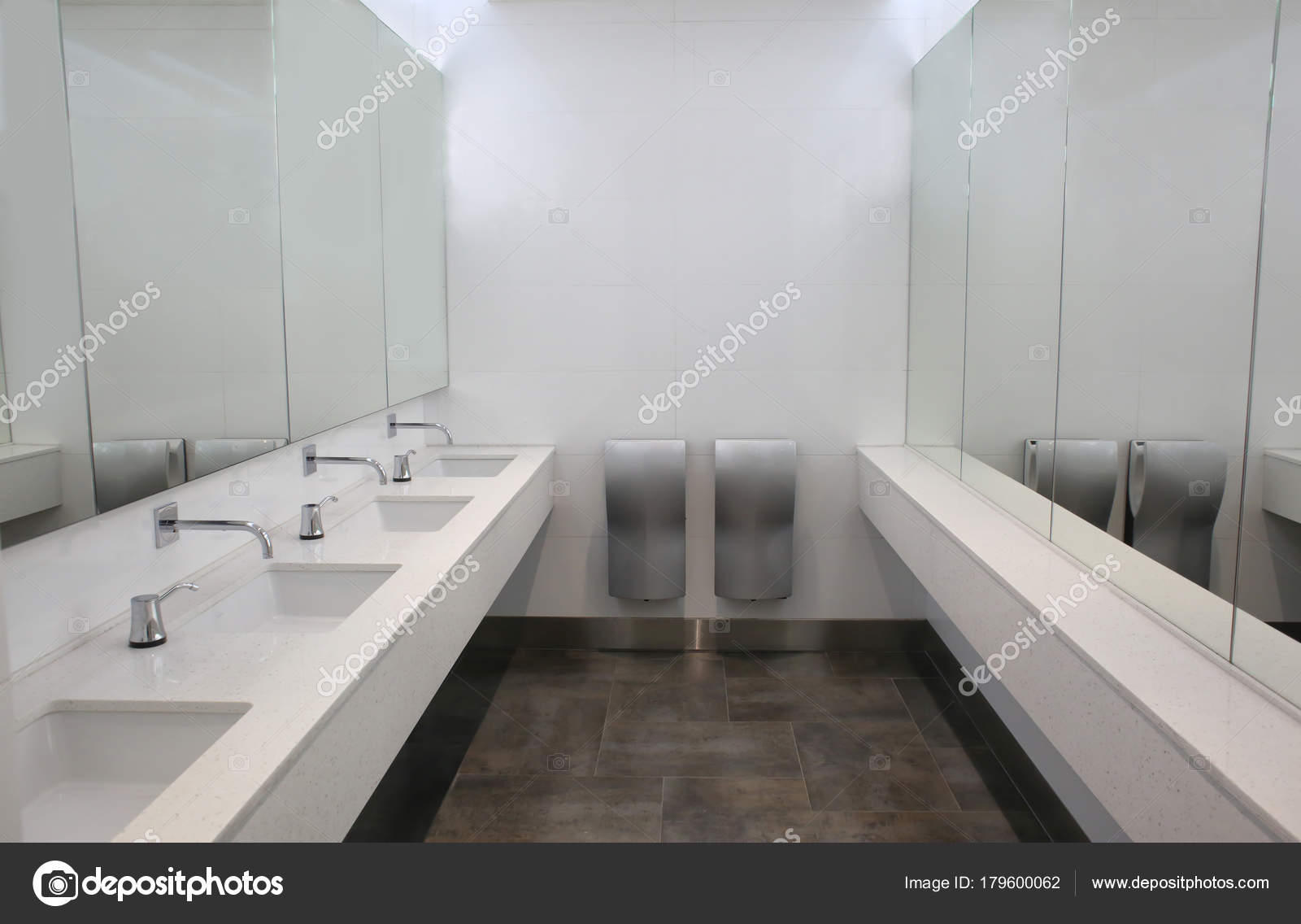 Modern sinks with mirrors in public toilet — Stock Photo ...