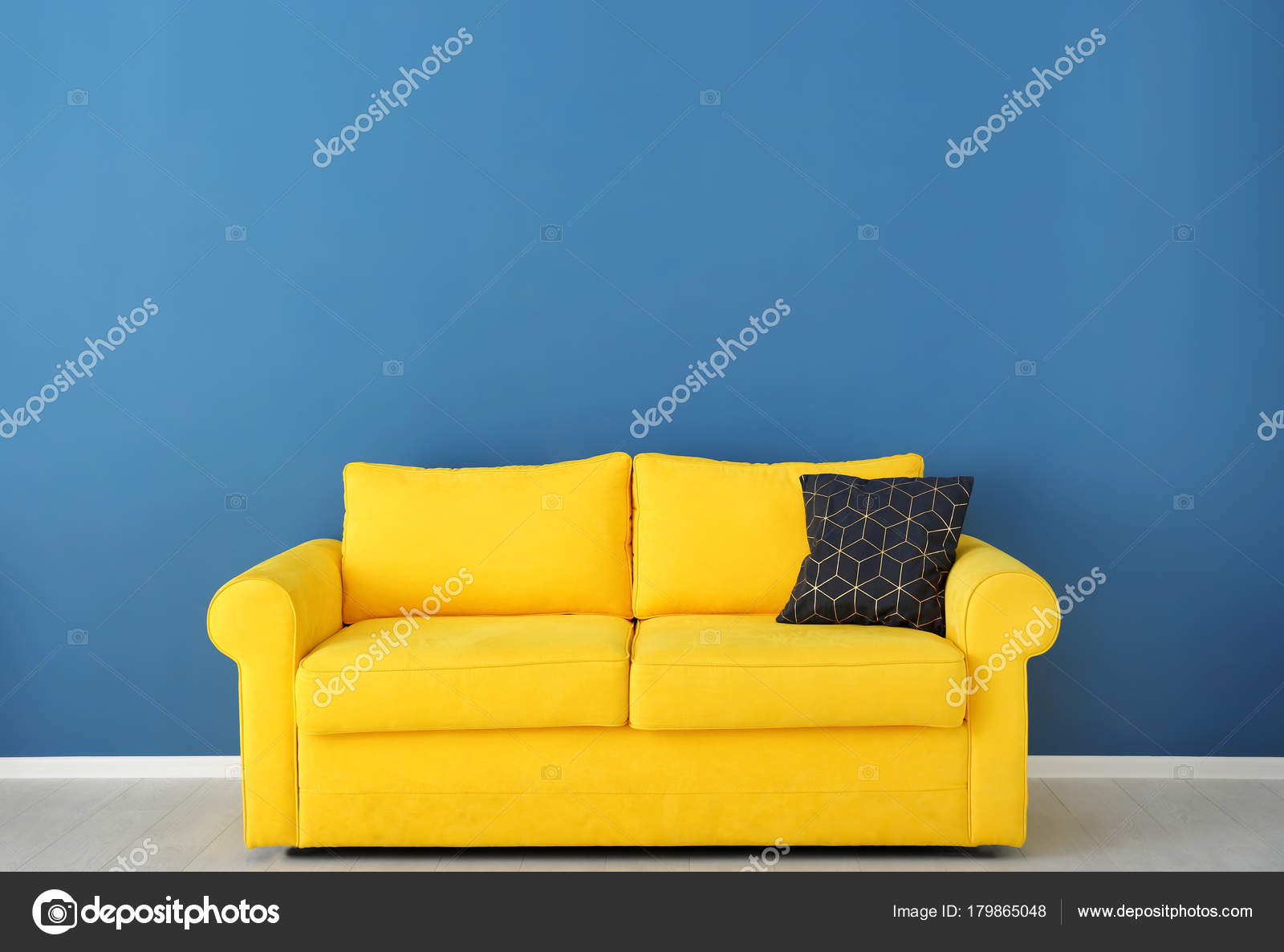 Bright Yellow Couch Color Wall — Stock Photo © belchonock #179865048