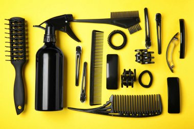 Professional hairdresser set on color background