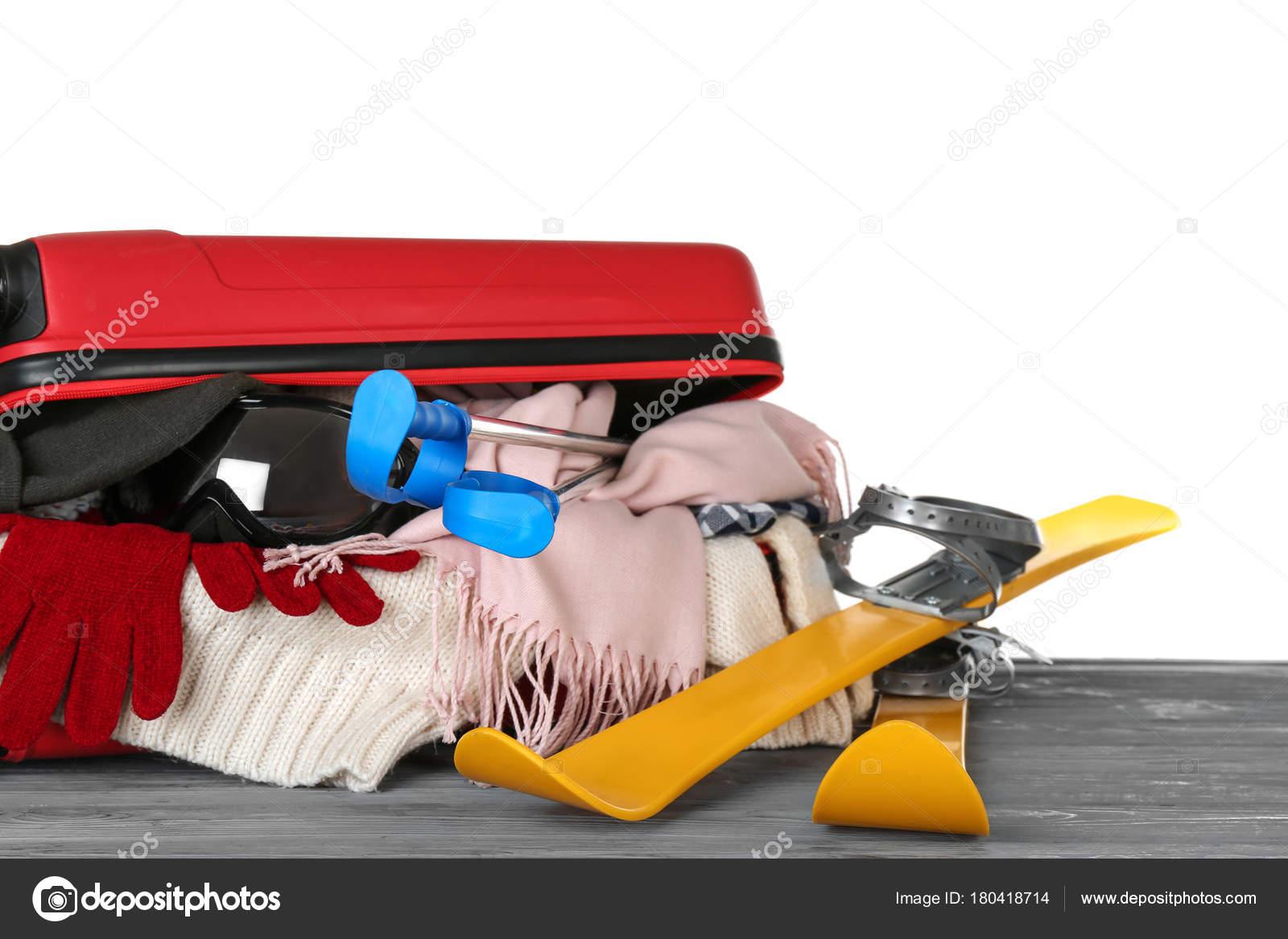 d9ba8f5a11d Open suitcase with warm clothes — Stock Photo © belchonock  180418714