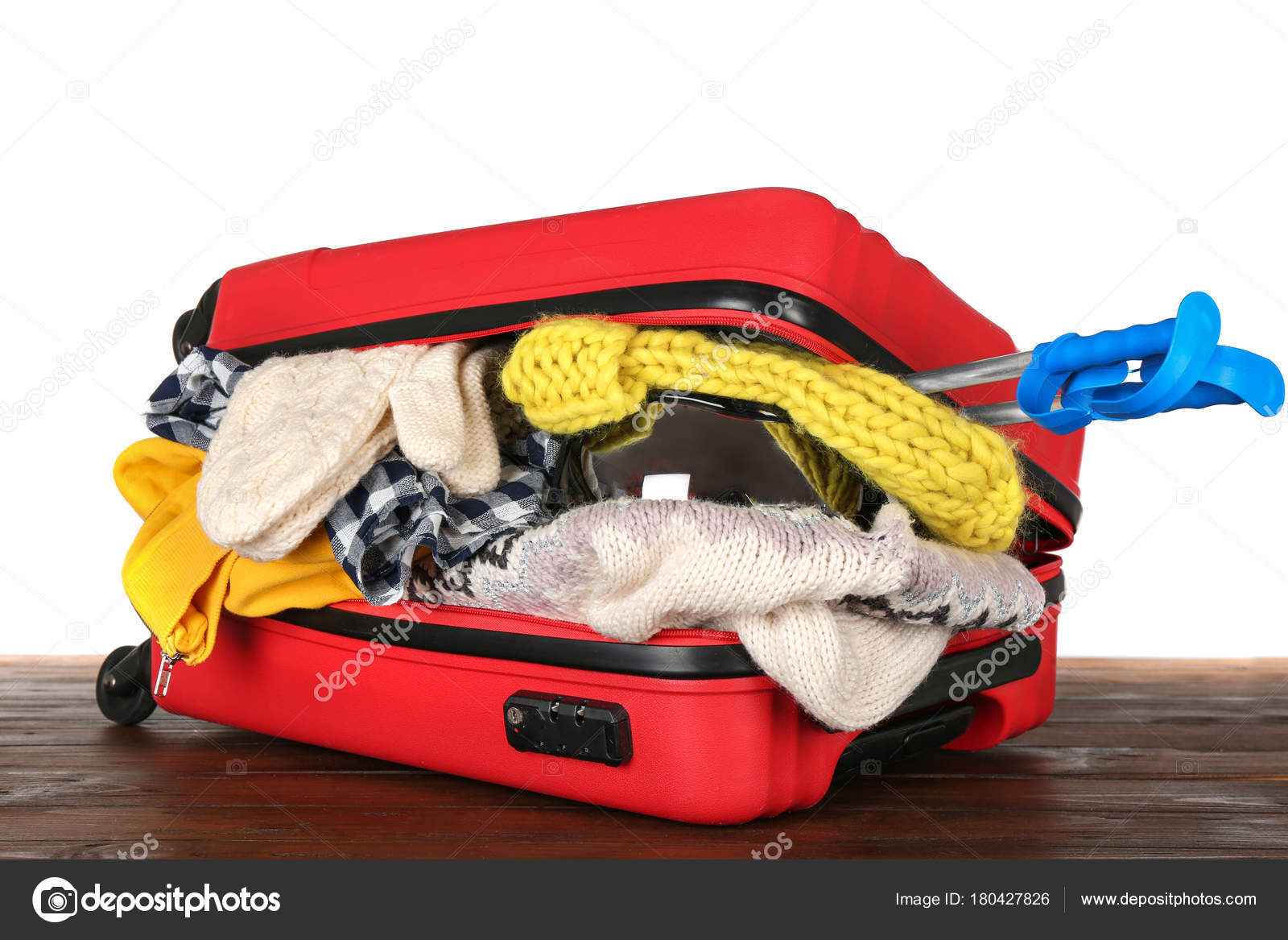 aaf3eb5741f Open suitcase with warm clothes — Stock Photo © belchonock  180427826