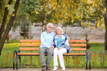 Cute elderly couple  on bench
