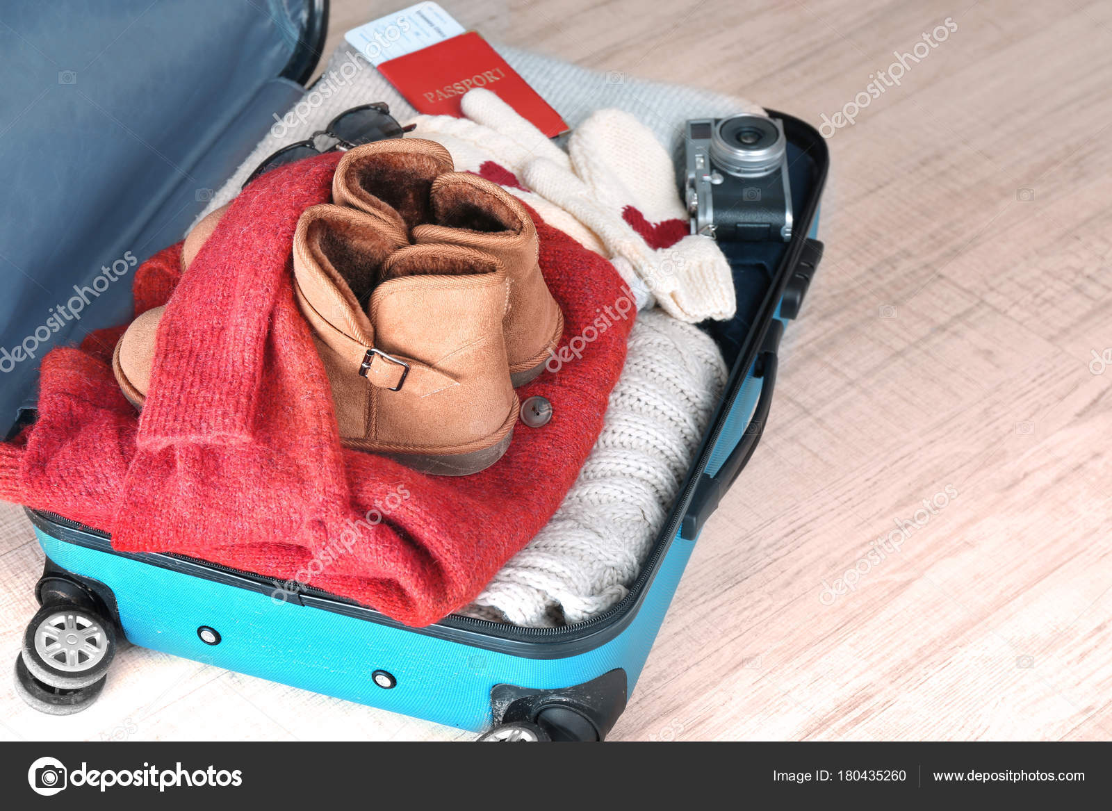 e3ef81c4dd2 Open suitcase with warm clothes — Stock Photo © belchonock  180435260