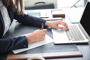 Young lawyer working in office, closeup