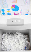 Destroying documents with shredder, closeup