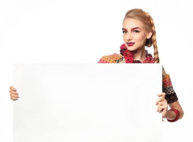 Young woman with advertising board on white background