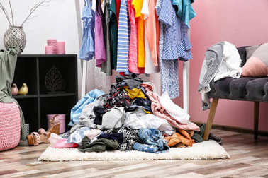 Messy dressing room interior with clothes rack