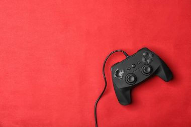 Video game controller on color background