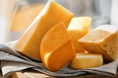 Sliced assorted cheese on windowsill