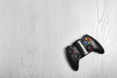 Video game controller on light background