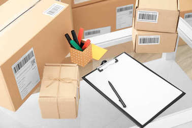 Parcels ready for shipment to customers on table in home office. Startup business