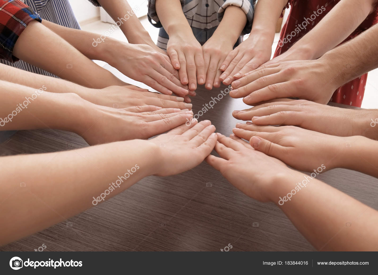 Young People Putting Hands Together In Circle As Symbol Of Unity Stock Photo C Belchonock 183844016