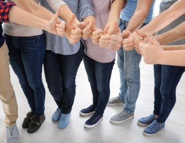 Group of people showing thumb-up gesture. Unity concept
