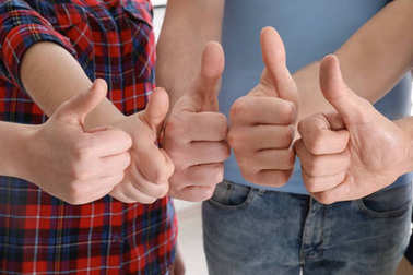 Group of people showing thumb-up gesture, closeup. Unity concept