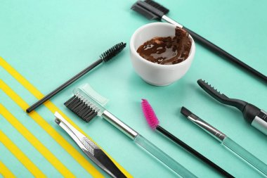 Set of tools for eyebrow dyeing and correction on color background