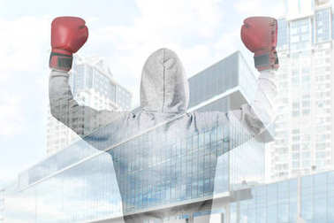 Double exposure of person with boxing gloves and cityscape background