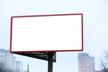 Blank advertising board on city street