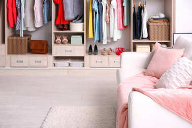 Cozy sofa and big wardrobe in dressing room