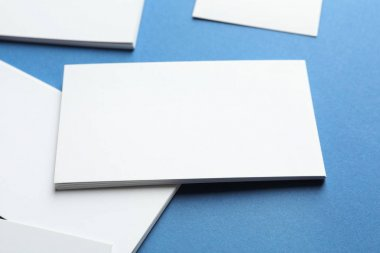 Blank business cards on color background