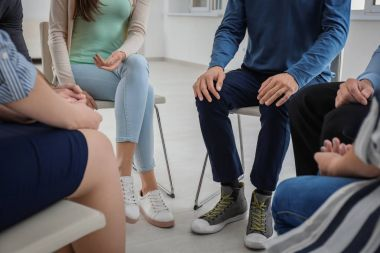 People at group psychotherapy session