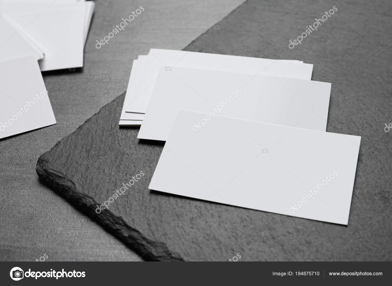 Blank business cards stock photo belchonock 184875710 blank business cards with slate plate on grey background photo by belchonock reheart Gallery
