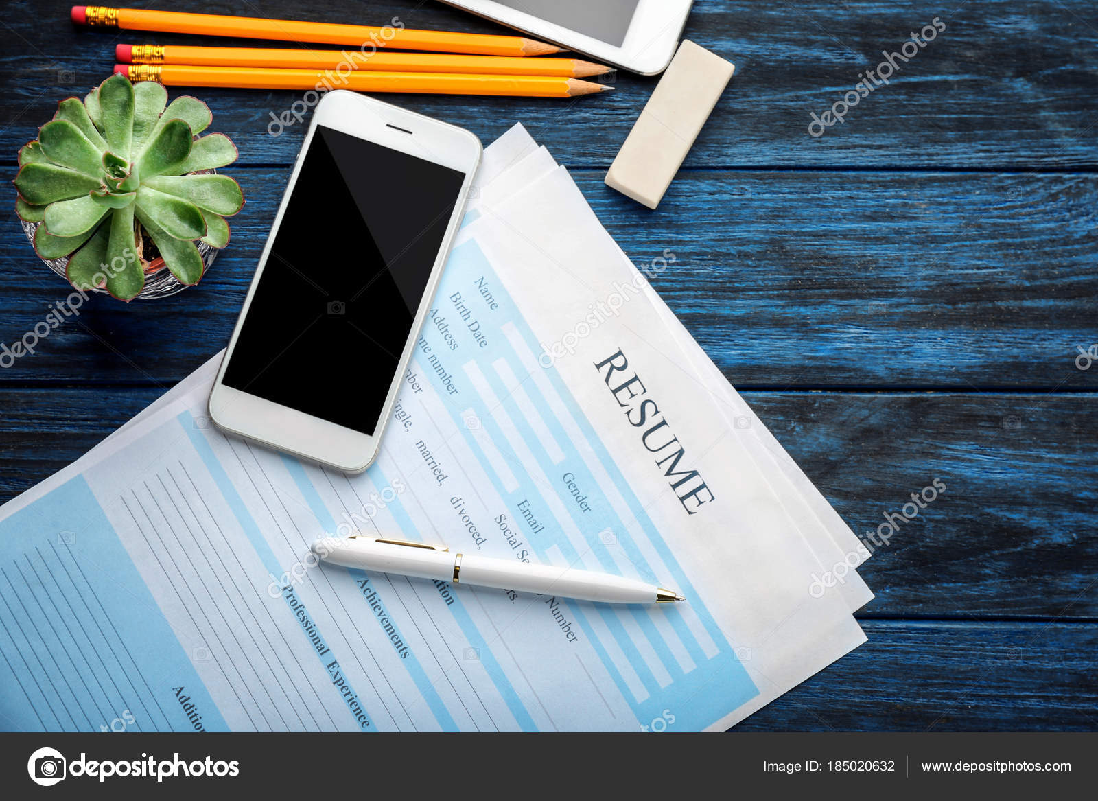 resume forms phone table job interview concept stock photo