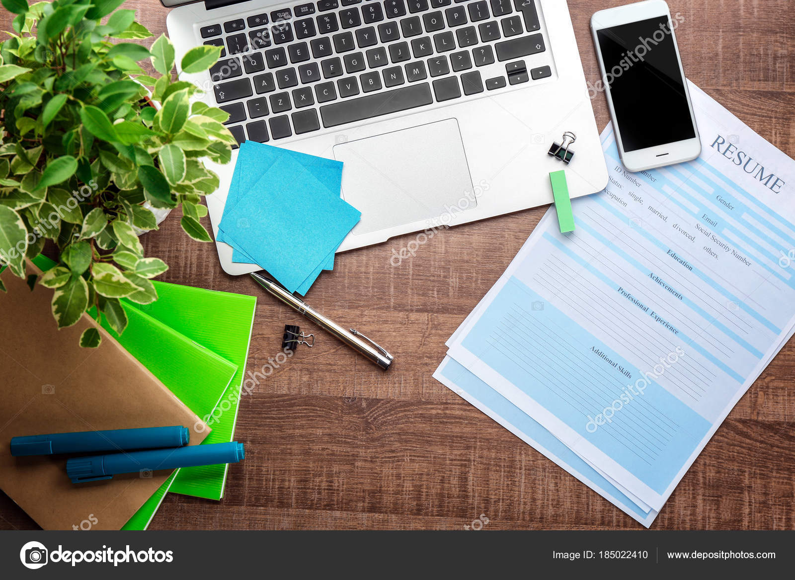 resume forms laptop office stationery table job interview concept