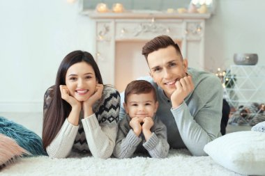 Happy family spending time together on winter vacation at home