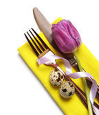 Beautifully decorated cutlery for Easter table setting with tulip on white background