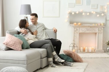 Young couple spending time together on winter vacation at home