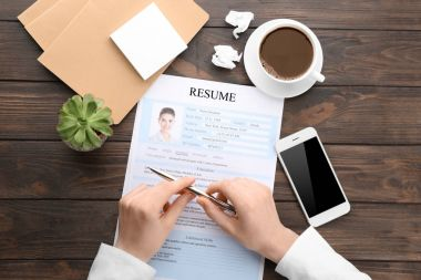 Woman with resume form at table. Job interview concept