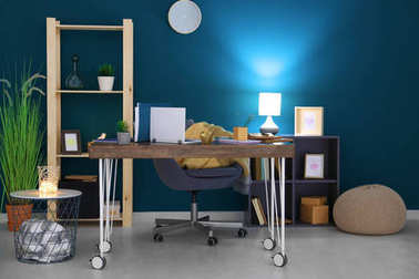 Comfortable home workplace with laptop on desk
