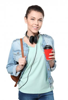 Teenage girl with headphones and cup of coffee, isolated on white